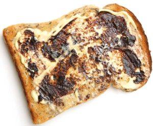 Scheibe Toast, gebuttert und mit Vegemite bestirichen